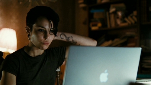 The Huntress' shadow in film: Lisbeth Salander, The Girl with the Dragon Tattoo. The survivor of a traumatic childhood, Salander is an androgynous, introverted and asocial computer hacker with a sadistic appetite for vengeance. She has difficulty emotionally connecting to people and making friends and is content to live in isolation.